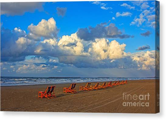Beach And Chairs With Cloudy Sky Canvas Print