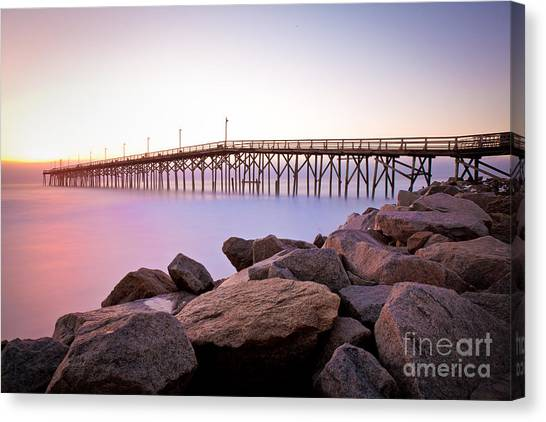 Beach Fishing Pier And Rocks At Sunrise Canvas Print