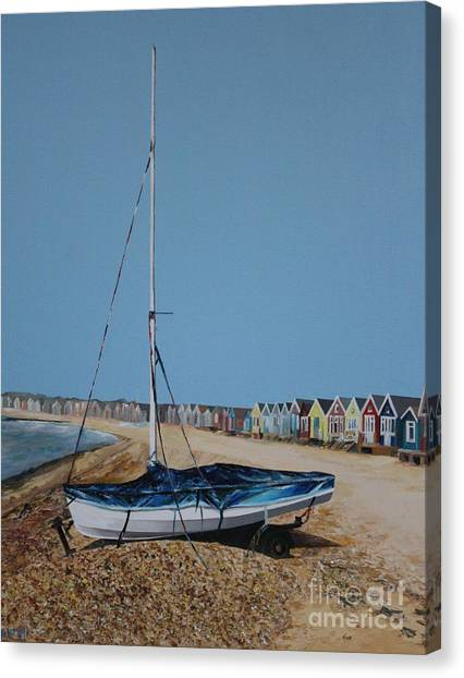 Beach Huts And Boat On The Spit Canvas Print by Linda Monk