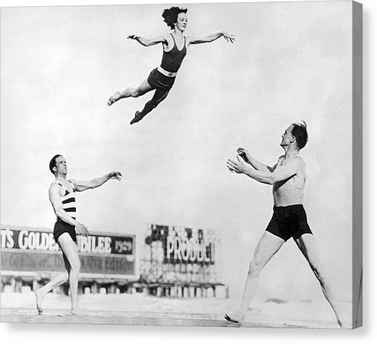 Acrobatic Canvas Print - Beach Performers Toss Woman by Underwood Archives