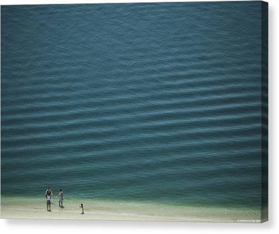 Beach Scene - Four People On Beach Canvas Print by Andy Mars