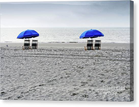 Beach Umbrellas On A Cloudy Day Canvas Print