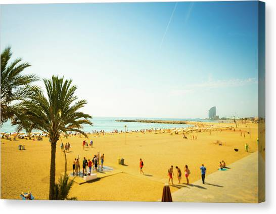 Beach With Parasol In Barcelona, Spain Canvas Print