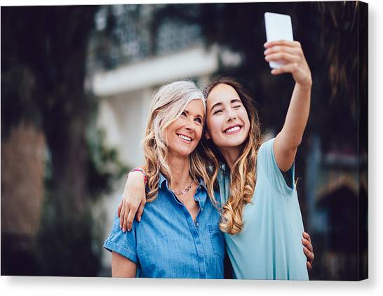 Beautiful Mature Mother And Adult Daughter Taking Selfies Together Canvas Print by Wundervisuals