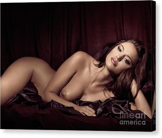 Beautiful Young Woman Lying Naked In Bed Canvas Print