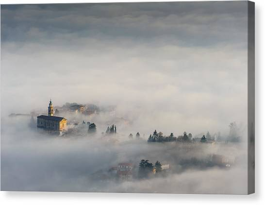 Between The Earth And The Sky Canvas Print by Roberto Marini