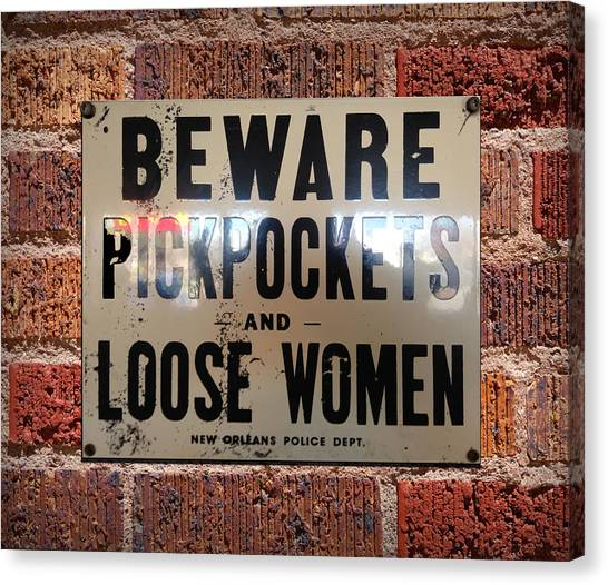 Beware Pickpockets And Loose Women Sign On Brick Wall Canvas Print
