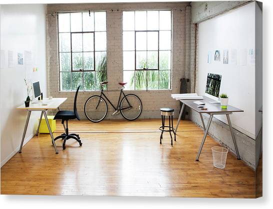 Bicycle And Desks In Modern Office Canvas Print by Sam Diephuis