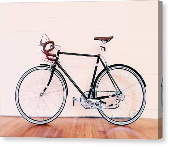 Bicycle Parked Against Wall Canvas Print by Markus Spiering / Eyeem