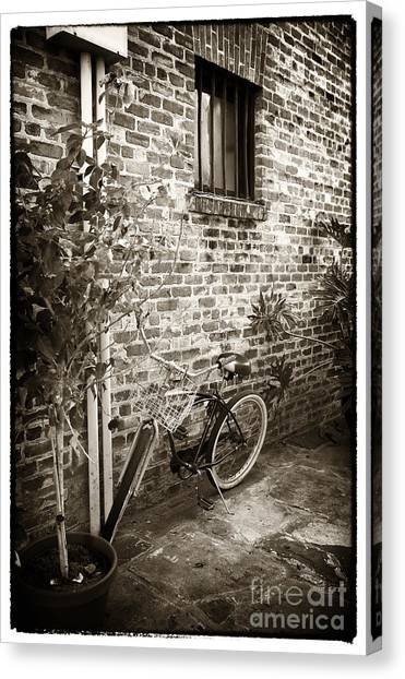 Bike In Pirates Alley Canvas Print by John Rizzuto