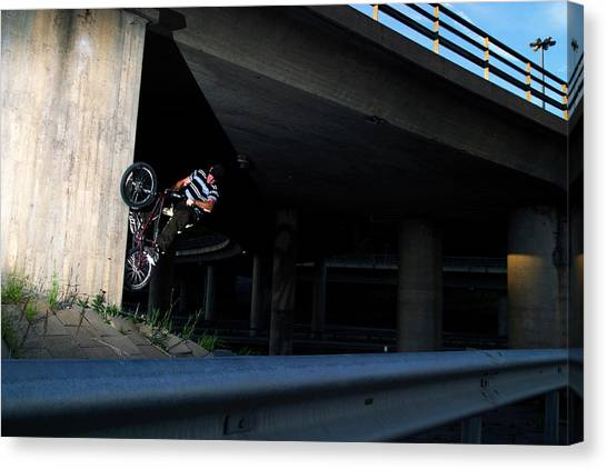 Freeriding Canvas Print - Bike Rider Is Jumping Beneath A Bridge by Patrik Lindqvist
