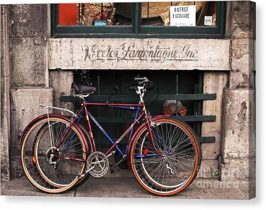 Bikes In Old Montreal Canvas Print by John Rizzuto