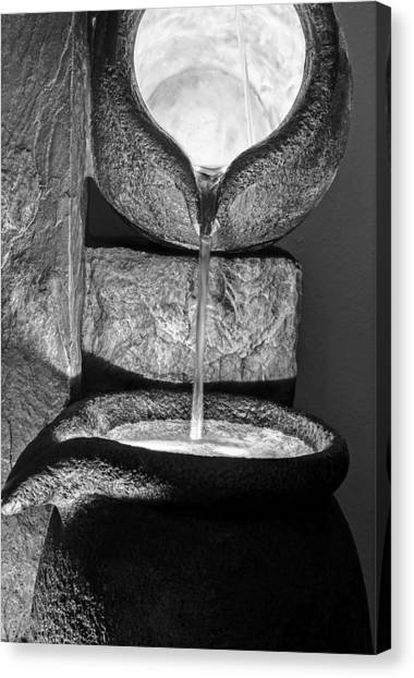 Black And White Water Pouring Forth From Large Stone Pots Canvas Print