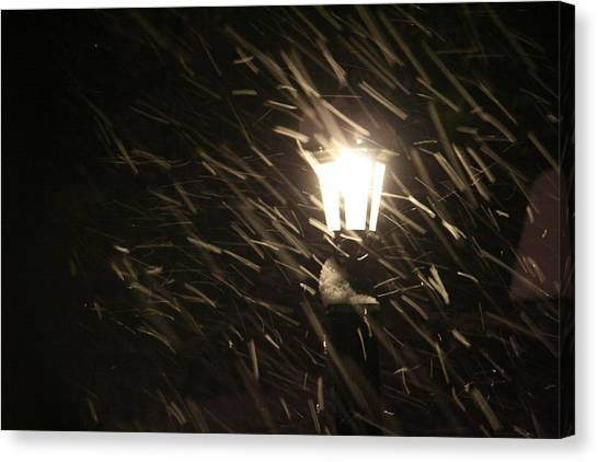 Blowing Snow Against Lamp Canvas Print by Carolyn Reinhart