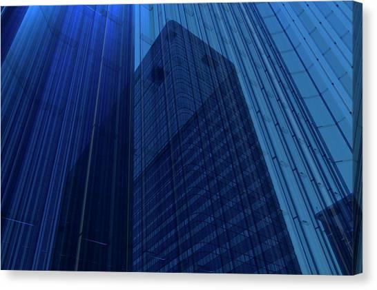 Blue Glass Building Canvas Print by Mmdi