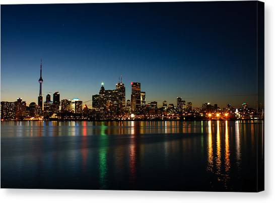Midnite Canvas Print - Blue Hour - Toronto's Dazzling Skyline Reflecting In Lake Ontario by Georgia Mizuleva