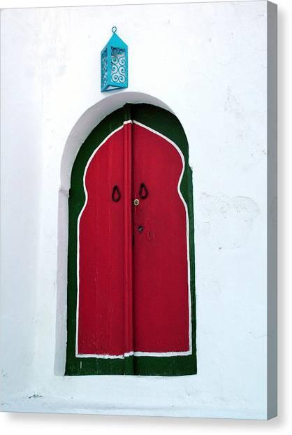 Blue Lantern Over Red Door Canvas Print
