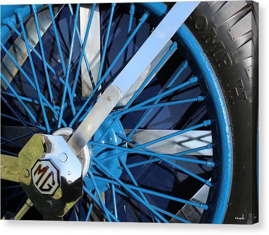 Blue Mg Wire Spoke Rim Canvas Print by Mark Steven Burhart