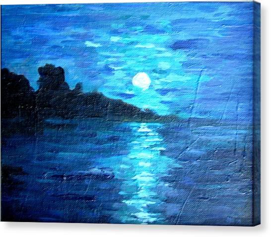 blue moon over lake couer da  lane Idaho Canvas Print