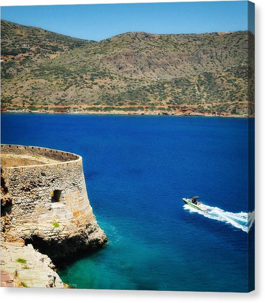 Greek Art Canvas Print - Blue Ocean And A Boat In Greece by Matthias Hauser