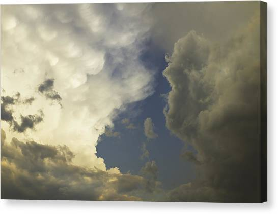 Rainclouds Canvas Print - Blue Sky And Building Dramatic Storm Clouds Maine by Keith Webber Jr