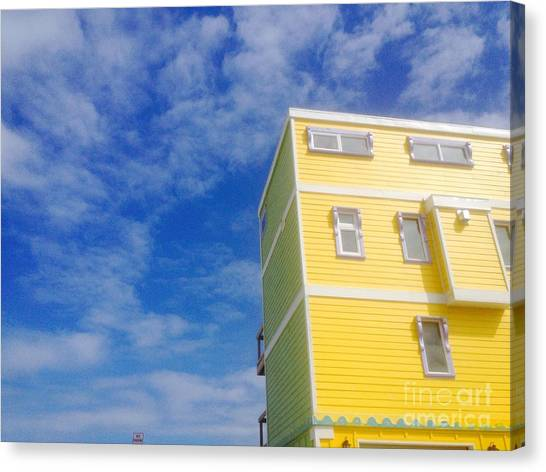 Blue Sky Yellow House Canvas Print