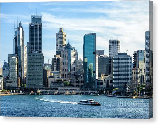 Blue Sydney - Circular Quay And Sydney Harbor With Skyscapers And Ferry Canvas Print by David Hill