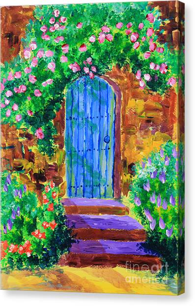 Blue Wooden Door To Secret Rose Garden Canvas Print
