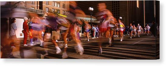 Accelerate Canvas Print - Blurred Motion Of Marathon Runners by Panoramic Images