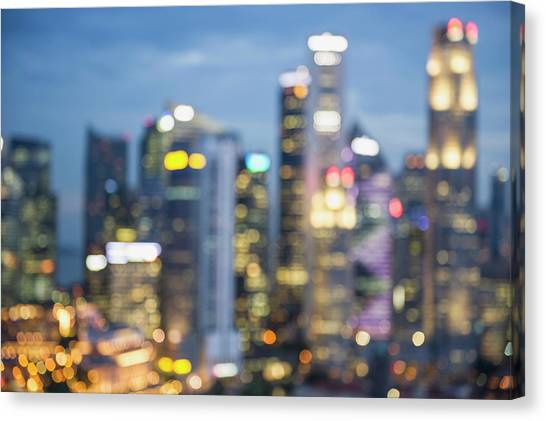 Blurred View Of City Skyline Lit Up At Canvas Print by Jacobs Stock Photography Ltd