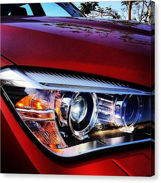 Car Badges Canvas Print - Bmw X1 Headlamp #bmw #x1 #headlamp by Rachit Hirani