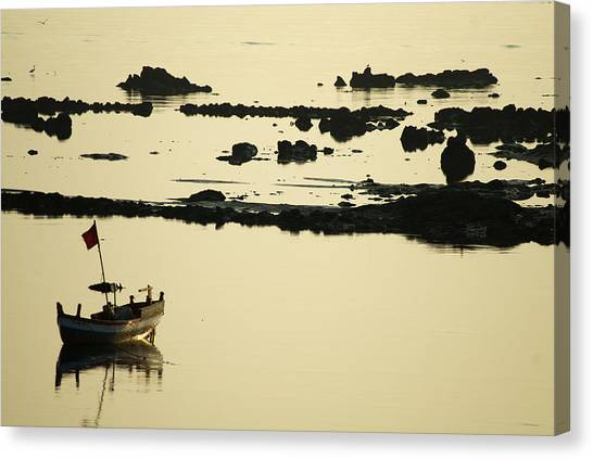 Boat Amongst The Rocks Canvas Print