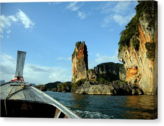 Boat And Rock Canvas Print by Money Sharma
