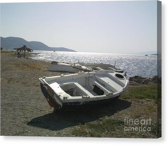 Boat On Alyki Beach Canvas Print by Katerina Kostaki