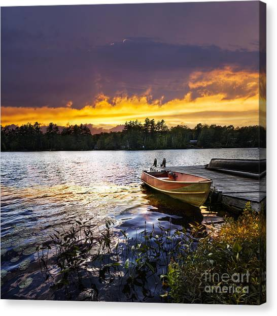 Orange Tree Canvas Print - Boat On Lake At Sunset by Elena Elisseeva