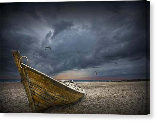 Boat With Gulls On The Beach With Oncoming Storm Canvas Print