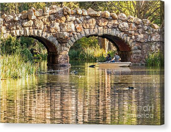 Boaters Under The Bridge Canvas Print