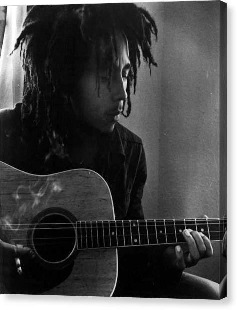 Jamaican Canvas Print - Bob Marley Leaning Over Guitar by Retro Images Archive