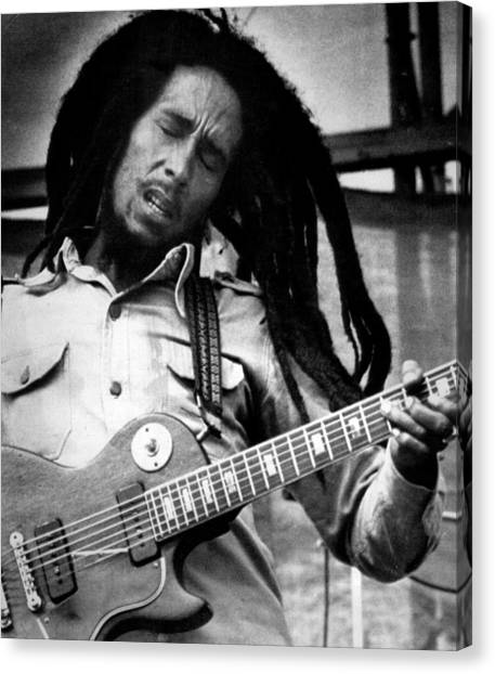 Jamaican Canvas Print - Bob Marley Playing Guitar by Retro Images Archive