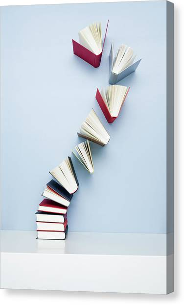 Books Taking Off From A Stack Canvas Print