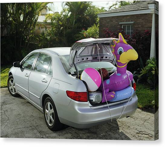Boot Of Car Packed With Inflatable Toy, Balls And Stereo Canvas Print by Baerbel Schmidt