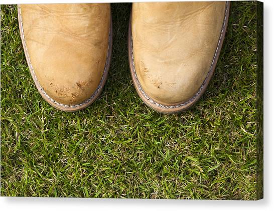 Boots On Grass Canvas Print