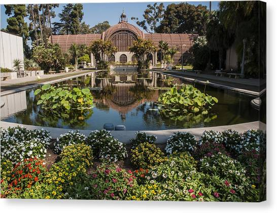 Botanical Building Reflecting In The Lily Pond At Balboa Park Canvas Print