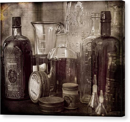 Bottles And Tins Canvas Print