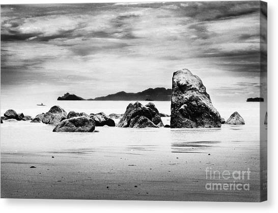 Boulders On The Beach Canvas Print by William Voon