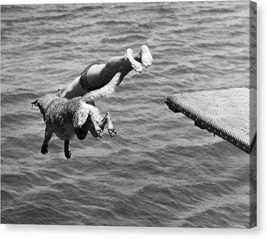 Monochromatic Canvas Print - Boy And His Dog Dive Together by Underwood Archives