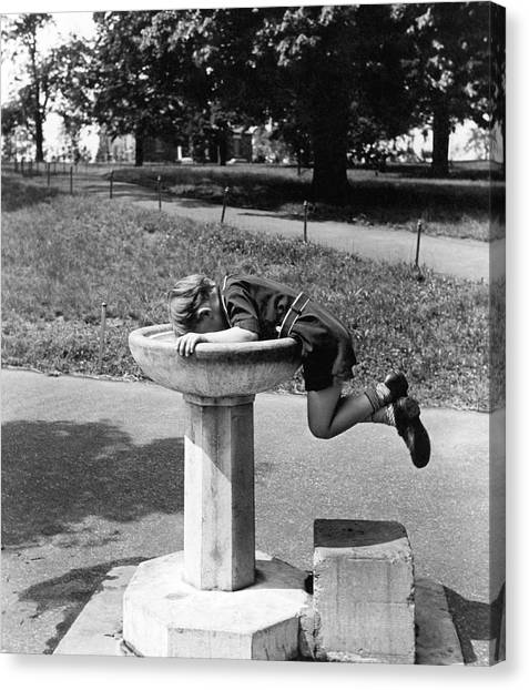 Boy Canvas Print - Boy Drinking From Fountain by Underwood Archives