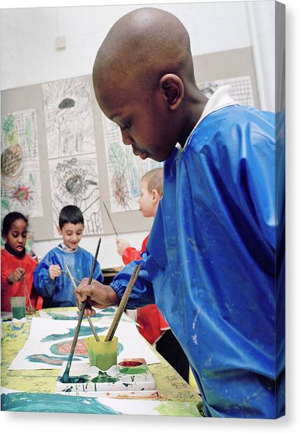 Classroom Canvas Print - Boy Painting At School by Martin Riedl/science Photo Library
