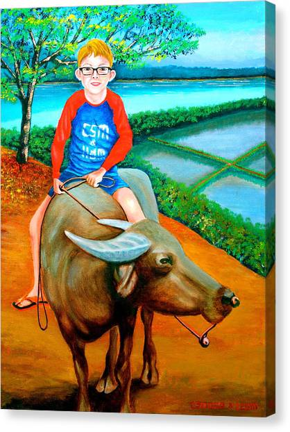 Boy Riding A Carabao Canvas Print