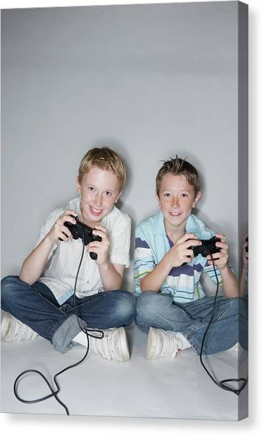 Playstation Canvas Print - Boys Playing A Video Game by Gustoimages/science Photo Library